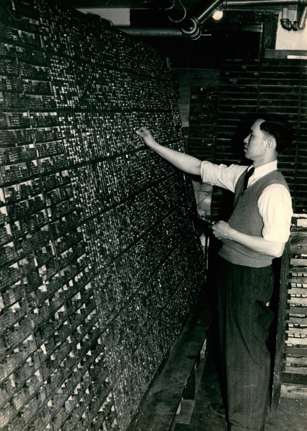 Henry Wong setting type at the Shanghai Printing Company, 1956 / 王耀敏在上海印刷公司排版,1956年
